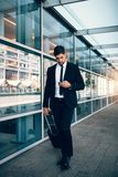 Handsome businessman using mobile phone at airport Royalty Free Stock Image