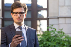 Handsome businessman using mobile phone Royalty Free Stock Photo