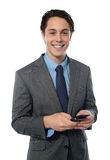 Handsome businessman using a smartphone Royalty Free Stock Photo