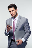 Handsome businessman using smartphone Royalty Free Stock Photo