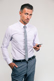 Handsome businessman using smartphone Royalty Free Stock Image