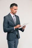 Handsome businessman using tablet computer Royalty Free Stock Image