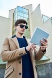 Handsome Businessman using Tablet Outdoors royalty free stock image