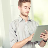 Handsome businessman using tablet pc Stock Image