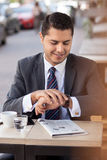 Handsome businessman is waiting for colleague in Royalty Free Stock Photography