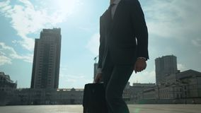 Handsome businessman walking around city, successful and self-confident man. Stock footage stock footage