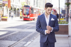Handsome businessman walking through the city Stock Photography