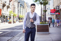 Handsome businessman walking through the city Stock Photos