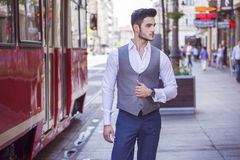 Handsome businessman walking through the city Stock Images