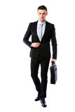 Handsome businessman walking with laptop Royalty Free Stock Photos