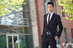 Handsome businessman walking to work Royalty Free Stock Photo