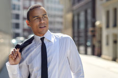 Handsome businessman walking in an urban street Stock Photos