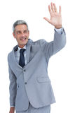 Handsome businessman waving Stock Photo