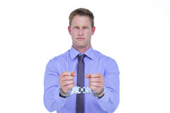 Handsome businessman wearing handcuffs Stock Images