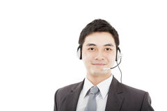 Handsome businessman wearing headset. Handsome asian businessman wearing headset and smiling isolated on white Stock Images