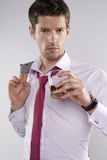 Handsome businessman after work drinking whiskey Stock Photography