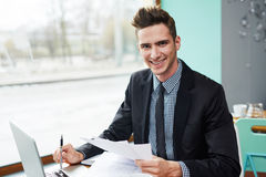 Handsome businessman working in coffeehouse Royalty Free Stock Images