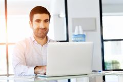 Handsome businessman working at computer Stock Images