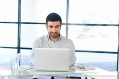 Handsome businessman working at computer Royalty Free Stock Images