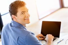 Handsome businessman working at computer Stock Image