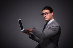 The handsome businessman working on laptop computer Stock Image