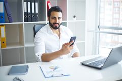 Handsome Businessman Working on Laptop at His Office.  Stock Images