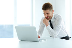 Handsome Businessman Working on Laptop at His Office Royalty Free Stock Photography