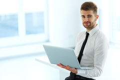 Handsome Businessman Working on Laptop at His Office Stock Photo