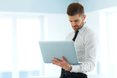 Handsome Businessman Working on Laptop at His Office Stock Image