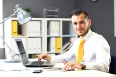 Handsome businessman working with laptop Royalty Free Stock Images