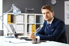 Handsome businessman working with laptop Stock Photos