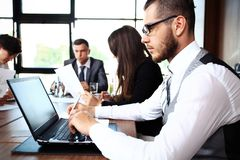 Handsome businessman working with laptop. In office Royalty Free Stock Images