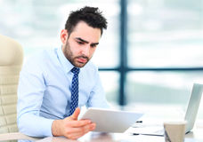 Handsome businessman working with laptop Royalty Free Stock Photography