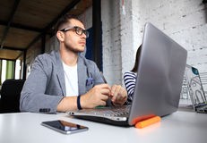 Handsome businessman working with laptop Royalty Free Stock Photos