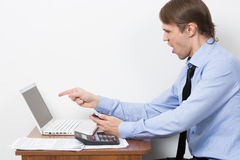 Handsome businessman is working with laptop in stock images