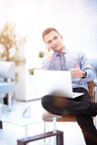 Handsome businessman working with laptop in office Royalty Free Stock Photography