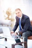 Handsome businessman working with laptop in office Stock Photography