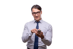 The handsome businessman working with mobile phone isolated on white. Handsome businessman working with mobile phone isolated on white Royalty Free Stock Photo