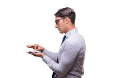The handsome businessman working with mobile phone isolated on white. Handsome businessman working with mobile phone isolated on white Stock Images