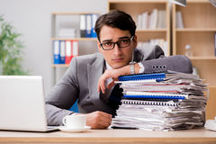 The handsome businessman working in the office Stock Photos