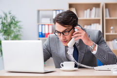 The handsome businessman working in the office Royalty Free Stock Photos