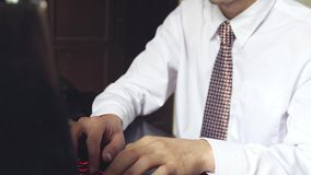 Handsome businessman working on an office. Young man typing on a laptop. slow motion. 3840x2160. Handsome businessman working on an office. Focused young man stock footage