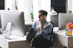 Handsome businessman working in office using mobile phone Stock Photography