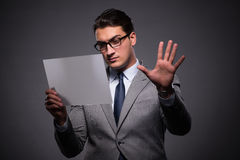 The handsome businessman working on tablet computer. Handsome businessman working on tablet computer Royalty Free Stock Photo
