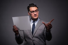 The handsome businessman working on tablet computer. Handsome businessman working on tablet computer Stock Image