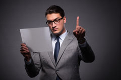 The handsome businessman working on tablet computer. Handsome businessman working on tablet computer Royalty Free Stock Photography
