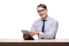 Handsome businessman working with tablet computer isolated on wh Stock Image