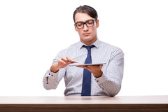Handsome businessman working with tablet computer isolated on wh Stock Photo