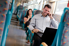 Handsome businessman working on the train Royalty Free Stock Photos