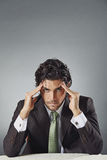 Handsome businessman with worried expression Stock Images